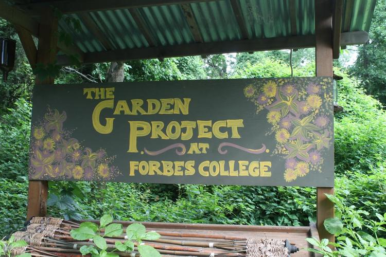 "A sign that says ""The Garden Project at Forbes College"""